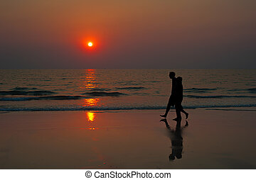 Sunset couple beach