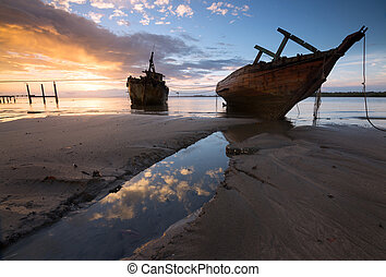 Old wrecked ship at sunrise