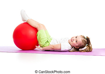 child girl doing fitness exercise with fitness ball