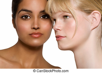 Ethnicities - Two beautiful women: Indian and Caucasian.