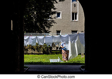 hang laundry in the backyard, a symbol of life, duties,...