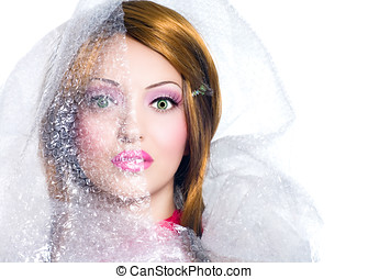 Wrapped Doll - Manipulated image of a doll-looking woman in...