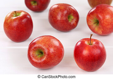 Red apple fruits on a wooden board