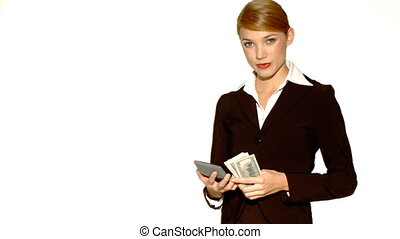 Beautiful young businesswoman is holding bunch of money