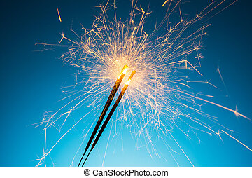 Ignited Sparkler - A group of Ignited Sparkler on blue...
