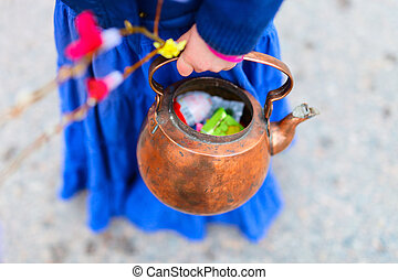 Easter celebration - Antique teapot full of candies and...