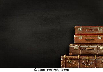 Suitcases on black background - Old suitcases on blank...