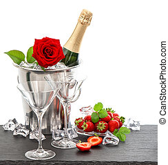 festive arrangement with champagne, red rose and strawberries