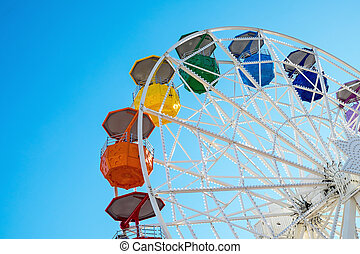Colourful ferris wheel - Detail of a colorful ferris wheel...