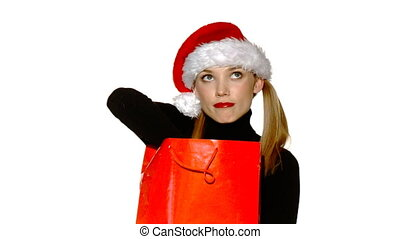 Sexy girl in santa claus hat with gift bag