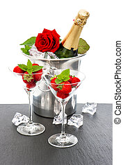 champagne, red rose and strawberries over white