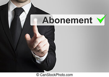 businessman pushing button abonement - businessman in black...