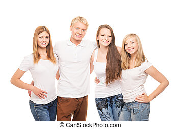 Group of young, stylish and happy teenagers isolated on...