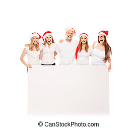 A group of happy and emotional teenagers in Christmas hats...