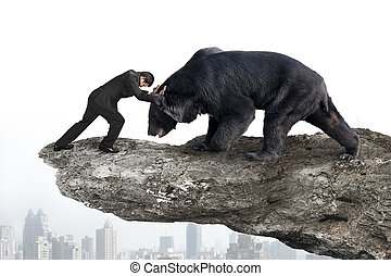 Businessman fighting against black bear on cliff with sky citysc