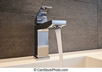 Very high end faucet, sink, and counter in a luxury bathroom...
