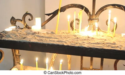 Candles burning in Catholic Church on Easter Sunday...