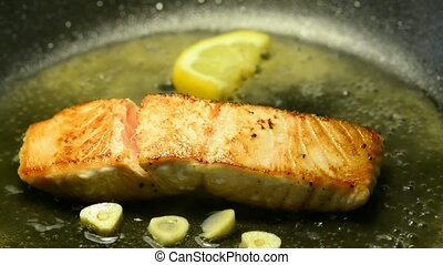 Salmon filet, roasting in a pan