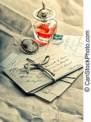 old love letters, antique accessories, perfume and cameo....