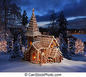 Gingerbread church on snowy Christmas night landscape -...
