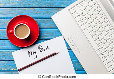 Coffee and paper with My Book inscription near notebook on...