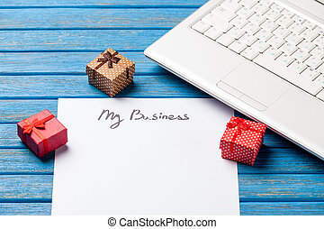 paper with My Business inscription near notebook on wooden...