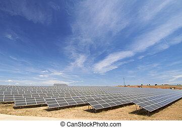 solar energy field - huge solar field with cloudy sky