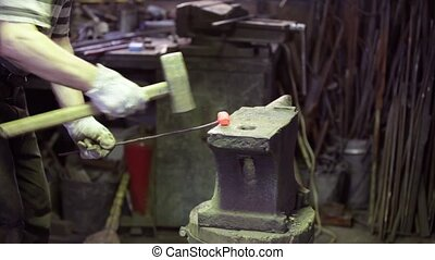 smith forging red hot iron - Blacksmith forging red hot iron...
