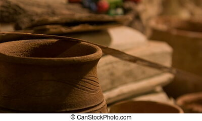 Interesting work of potter - Crockery. Selective focus on...