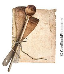 Vintage wooden kitchen utensils and old cookbook page...
