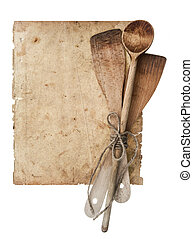 Retro kitchen utensils and old cook book page isolated on...