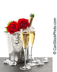 bottle of champagne, two glasses and red roses