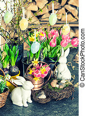 Easter bunny and eggs decoration. Spring flowers tulips,...