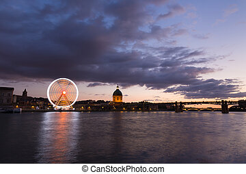 Nightly view of the Garonne river at dusk