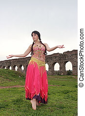 odalisque - belly dancer with ancient Roman aqueducts ruins