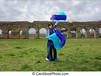 blue odalisque - blue belly dancer under the Roman aqueduct