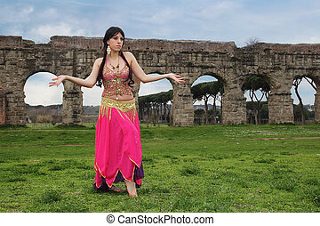 odalisque - belly dancer with ancient Roman aqueducts ruins...