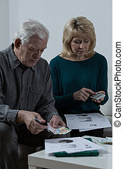 Elder marriage analyzing family budget - Image of elder...