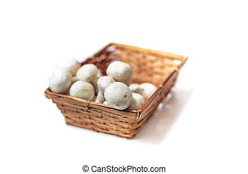Basket with bunch of white mushrooms close up differential...