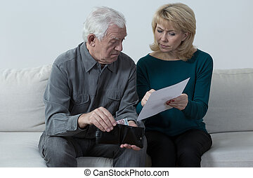 Pensioners having financial problems and analyzing bills