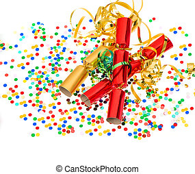 party cracker, golden streamer and confetti