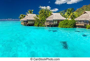 Overwater villas in lagoon of Moorea Island - Overwater...