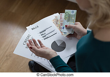 Woman paying off the loan analyzing her budget