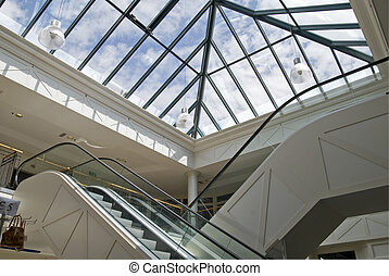 Escalators - Escalator in a mall with glass roof