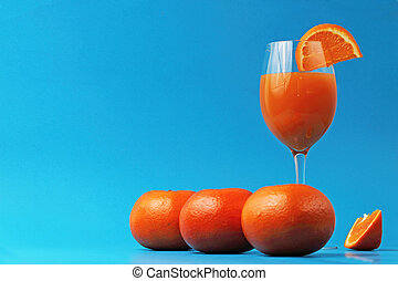 orange juice glass with oranges