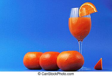 orange juice glass with oranges