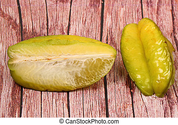 star fruit on a wood table top