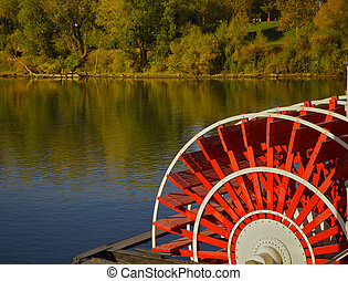 riverboat paddles - red river boat paddle wheel in water...