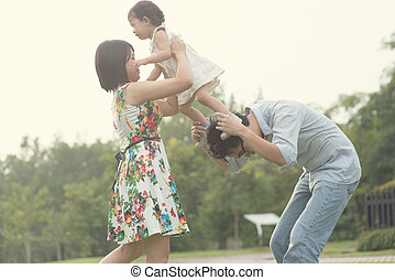 asian family playing and enjoying quality time outdoor ,...