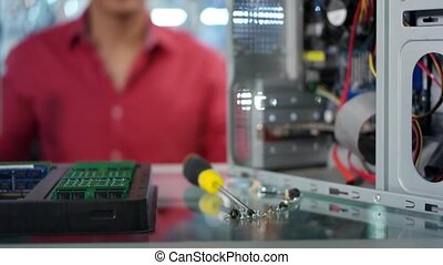 Chinese Man Reparing PC - Young asian shop owner working in...